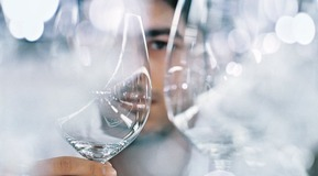 Man inspecting wine glasses