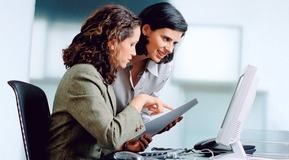 Two Businesswomen with computer in an office.